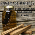 oak stave aging in moonshine mason jar